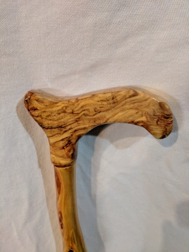 The handle is made from aspen burl.